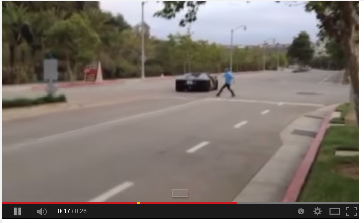 Guy throws rock at lamborghini